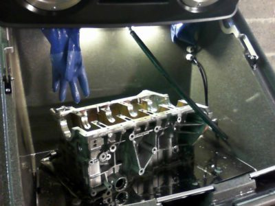 Cleaning BMW header in Torrent 500 parts cleaning machine